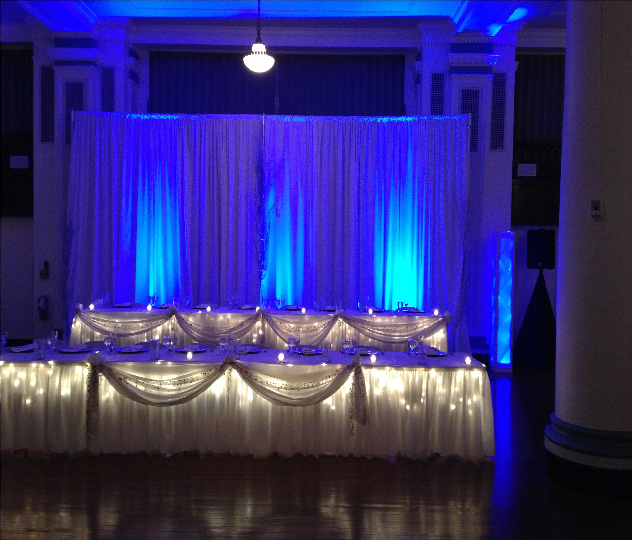 Blue up lighting rental in Fort Wayne, IN. Rent uplight in blue color for wedding lighting.
